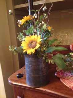 Antique sifter  and sunflowers