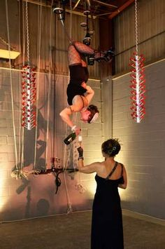 "A ""Bubbly Babe"" pours champagne while hanging upside down"