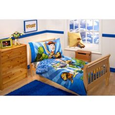Disney Buzz, Woody and the Gang 4-Piece Toddler Bedding Set - BedBathandBeyond.com