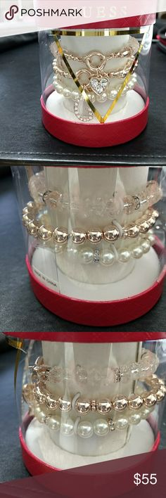 Guess rose gold tone charm bracelet set Pink beads, faux pearls and rose gold are the colors of these bracelets. They are accented with rhinestones. Guess Jewelry Bracelets