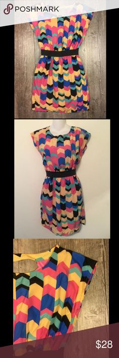 Multicolor chevron cinch waist dress Multicolor chevron cinch waist dress. Elastic black waistband. Slip attached. Open back, buttons in back. 34 inches long. Pockets. Tag reads small. Emmelee Dresses