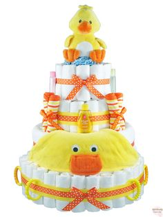 Our Sunny Ducky Diaper Cake is sure to brighten mommy's day!  It is loaded with diapers and bath time items.  Baby will love being cuddled in the towel and playing with the soft plush ducky on top!  Great for a baby boy, girl, or surprise!  http://www.rattlecake.com/diaper-cakes/sunny-ducky-diaper-cake-4-tier.html  $148