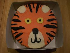 TIGER CAKE--kinda simple butt if we can't do fondant (and we can't for sure) then this may be the simplest?  Thoughts??  bel