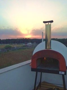 "Portable wood fired oven ""Subito Cotto 80"" by Zio Ciro with red mouth..... fantastic location!!"