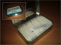 These cookie fortunes nuzzling the edges of an Altoids tin. | 22 Objects Fitting Perfectly Into Other Objects