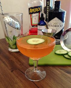 Ingredients: 2 1/4oz Hendricks Gin .5oz Aperol .5oz St. Germain .25oz Simple Syrup 5 drops Bittermens Hopped Grapefruit Bitters 6 Cucumber slices  instructions:  Place 5 cucumber slices in a chilled mixing glass. Add the simple syrup. Muddle the cucumbers. Add gin, Aperol, St. Germain and bitters. Add ice and stir. Double strain into a chilled cocktail glass and garnish with the remaining cucumber slice.