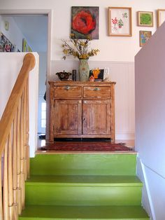 Nest decorating. I love this woman's home. It encapsulates all that I'd love. Lots of lovely curated objects, used, with colour used creatively. Art, collections, just visually interesting wherever one looks. Beautiful. Check out the green stairs.