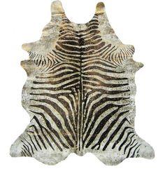devore metallic zebra hide | Zebra hide rug with metallic speckles.