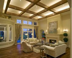 Very tall ceilings and exposed beams highlight this remodeled living room that was completed in under 6 weeks. Traditional grandoise fireplace, white mantel, French doors and hardwood floors all put a positive spin on this remodel. Wood Ceilings, Ceiling Beams, Ceiling Windows, Tall Ceilings, Paint Colors For Home, House Colors, Room Colors, Home Ceiling, House Design Photos