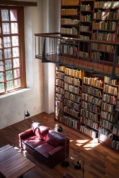 Library-I love this idea but I just keep thinking that the window (and all that light) is going to ruin some of those books