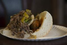 The 'Treat' sandwich, a customer favorite, with sausage and Italian beef, at Tootie's Famous Italian Beef on the South Side