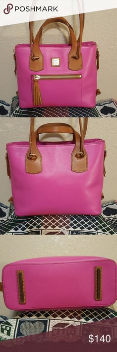 Dooney & Bourke Morgan satchel Christine used conditioned I've only used it once beautiful beautiful leather bag nice to have the Satchel handles and the shoulder straps guess it's opened on the sides to make larger Dooney & Bourke Bags Satchels