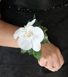 The Super Glam Bridesmaids looked amazing in their elegant black gowns wearing Phalaenopsis Orchid Wrist Corsages