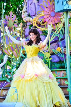 Play the part of Belle. Either at Disneyland or in the play Beauty and the Beast or a movie.
