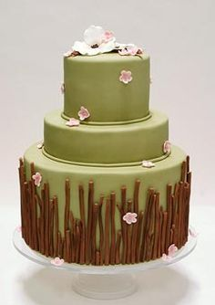 Unusual green and brown, three tier country wedding cake, decorated with earthy tones