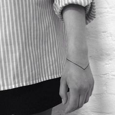 Triangular bangle tattoo - Minimalist and tiny tattoo inspiration from geometric shapes to linear patterns | Stylist Magazine