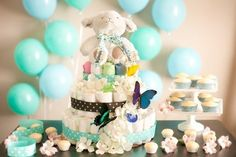 A cake where the top tier is made from colorful washcloths and teething blankets.   19 Stunning Diaper Cakes Anyone Can Make