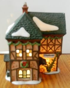 """dept 56 dickens village """"T. Puddlewick Spectacle Shop"""""""