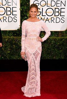 Chrissy Teigen wearing a blush pink Zuhair Murad gown and Harry Kotlar diamonds at the 72nd Annual Golden Globes