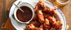 Avoid Buffalo burnout and bake up a batch of these bacon-wrapped chicken wings for your next get-together. The homemade barbecue sauce, made with pantry staples and a generous pour of bourbon, gives them a special finish.