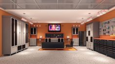 Ashley: If your vehicles don't need a place to live, why not convert the garage into the ultimate man hangout? This huge space packs plenty of storage for tools, gadgets, computers, food, and all kinds of toys and more. The warm orange hue softens and makes for an unexpected manly treat. A rug adds some texture and warmth in an otherwise fairly sterile environment.