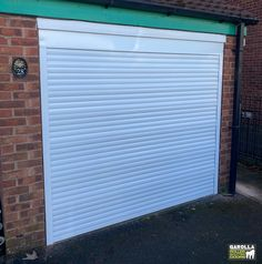 Roller Garage Doors from Garolla are superb. If you're looking for 'garage door companies near me', you'll be pleased to know that we install electric garage doors around the UK. Click the link to see all of our electric roller garage doors. White Garage Doors, Electric Garage Doors, Carriage Garage Doors, White Doors, Electric Rollers, Garage Door Company, Roller Shutters, Shutter Doors, White Gardens