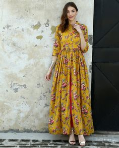 New Stunning Marigold Block Printed Cape Dress Band Collar f Button Flare cotton Kurta Designs Women, Blouse Designs, Pakistani Dresses, Indian Dresses, Skirt Fashion, Fashion Dresses, Women's Fashion, Fashion Trends, Kurti Designs Party Wear