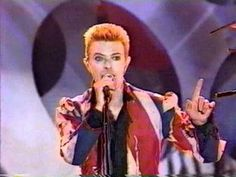 """SIGN.BACKED.BY.THE.MOB.""""ENUNCIATION LEADS INTO EXALTATION"""".YOUR GREATEST ENEMY IS YOUR BEST ASSET""""..SUSAN(VISION)..David Bowie '96 Fashion Awards-Fashion."""