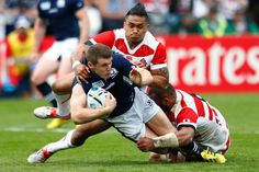 Rugby World Cup 2015 - Match Centre - Match 9 - Sept.23 2015 - Scotland 45 - Japan 10 - Group B: Rugby World Cup 2015 MARKED MAN: Scotland's Mark Bennett is brought crashing to the ground by the combined efforts of Male Sau and Michael Leitch (r)