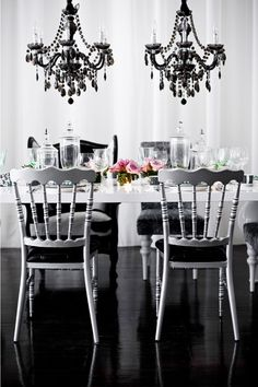 Black, White & Gray with a pop of color + chandelier love - gorgeous.