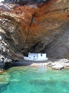 "Santorini, Greece - a little ""fishermen's church"" that was tucked away in the rock"