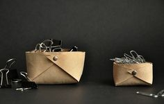 Container: DIY Leather Baskets via Between The-Lines Blog I Remodelista