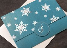 Arabella Papers Custom Holiday Cards and Invitations - beautiful, fun rich Bellpress printed design with turquoise and white snowflakes, plus monogram.