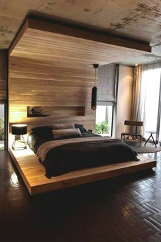 Wood bed enclosure.  Wonderful way to make a room within a room and provide bed privacy.  Soften this look up with hanging fabric and a chandelier.