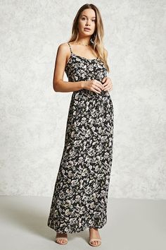 This crepe woven maxi dress features a floral print, adjustable cami straps, a scoop neckline, and an elasticized waist.