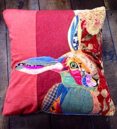 Hand made appliqued pillow, of a hare on a velvet, tweed and red background. A…