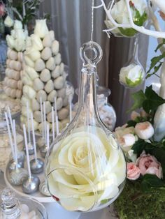 Hanging rose decoration at a white wedding party! See more party planning ideas at CatchMyParty.com!