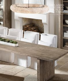 I like the wood table, green centerpiece, and the bright fabric slipcovers on the dining room chairs. As long as the slipcovers are removable and washable, we're good! Slipcovers For Chairs, Upholstered Dining Chairs, Dining Room Chairs, Dining Rooms, Teak Dining Table, Wood Table, Rustic Table, Monochrome Interior, Interior Design