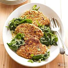 The chicken for this low-fat main dish recipe is first dipped in an egg mixture and then rolled in an almond mixture to give it a crunchy texture. The quickly wilted spinach complements the crusted chicken.
