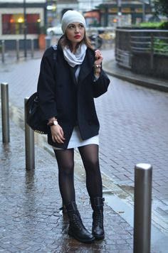 Dress and booties in a rainy Milan