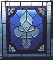Various shades of blue, periwinkle. Stained glass hanging window panel. www.treasuresoflight.com