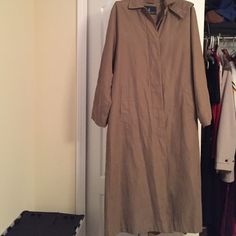 Ladies water resistant trench coat Lightweight London Fog lined microfiber water resistant full length overcoat with hood. Concealed buttons. Taupe color. Size 6 regular. London fog outerwear is cut large.  Bought it on business trip to MD due to lots of rain but really haven't worn it since. Excellent condition length is mid calf London Fog Jackets & Coats Trench Coats