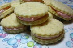 Betty Crocker Cream Wafers. I have been making these since the 70's. Shhhh--no need to figure out my age! They will melt in your mouth. For each holiday I just change the color of the icing between them:) They look like little tea cakes.