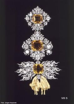 "Jewel of the Order of the Golden Fleece 'From Brazilian Yellow Topaz"". Pallard, Jean Jacques (Goldsmith), Geneva or Vienna, 1755-1756. Three step-cut topaz, 369 diamonds, gold, silver. Total H 15.2 cm; Order: 10.9 x 8.0 mm; trailer: 4.3 x 4.5 cm. VIII 5. Green Vault © Dresden State Art Collections 2013"