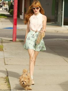 Matchy, matchy: Bella's pale green skirt worked well with her sunglasses creating a stunning dog walking look