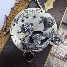 Swiss pocket watch parts with fierce dragon and rose. Who could resist such a charming necklace?