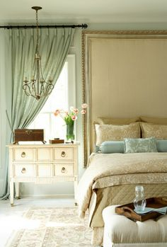 huge framed upholstered wall for headboard, ceiling to floor curtains (note the moulding detail above window) in calm colors
