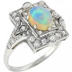 Art Deco Style Oval Cut Australian Opal and Round Cut Diamond White Gold Ring. Opal Jewelry, Art Deco Jewelry, Jewelry Rings, Jewelry Accessories, Fine Jewelry, Jewellery, Antique Jewelry, Vintage Jewelry, Matching Rings