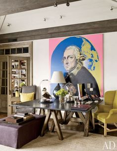 A painting by Andy Warhol animates this living room wall in a Zurich home designed by Steven Gambrel.