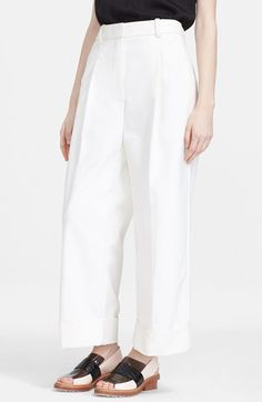 White wide leg pants with nice casual flats.